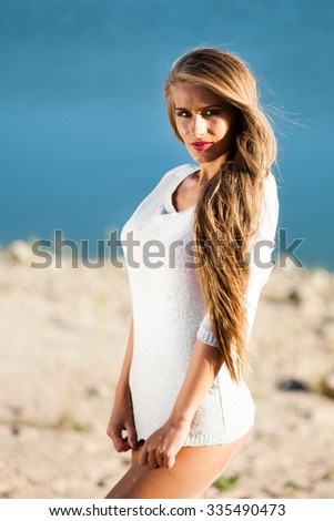 Happy long hair woman on beach in a short white dress. - stock photo