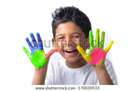 Happy looking kid playing with paints in his fingers. - stock photo