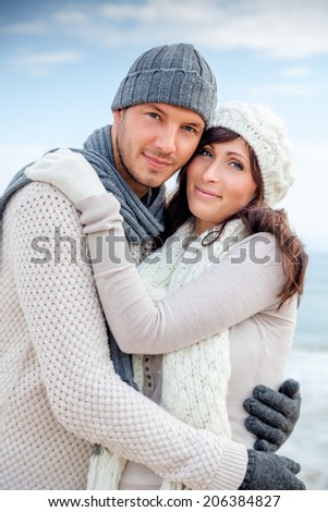 happy lovely couple enjoying colder season - stock photo