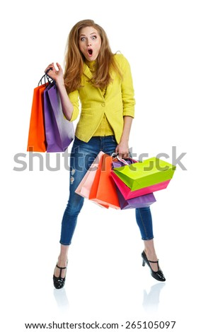 Happy lovely woman with shopping bags over white background - stock photo