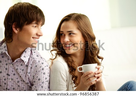 Happy lovers looking at each other and flirting - stock photo