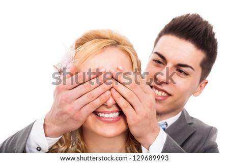 Happy loving couple having fun, isolated on white background. - stock photo
