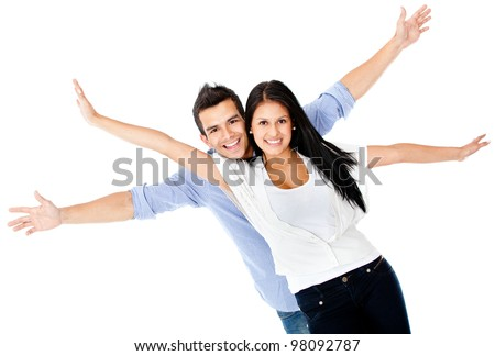 Happy loving couple with arms up - isolated over a white background - stock photo