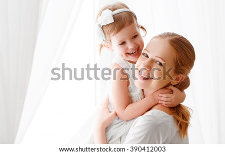 Happy loving family. mother and child girl hugging and hugging - stock photo