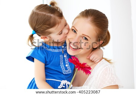 Happy loving family. mothers Day. daughter gives her mom flowers - stock photo