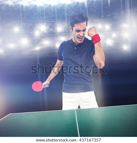 Happy male athlete posing after victory against american football arena - stock photo