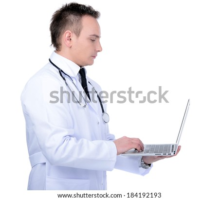 Happy male doctor showing on a laptop on a white background - stock photo