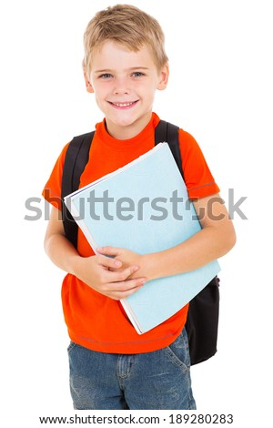 happy male elementary pupil holding books - stock photo