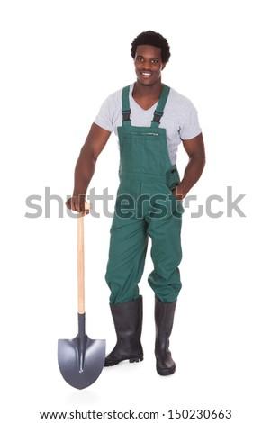 Happy Male Gardener Holding Shovel Over White Background - stock photo