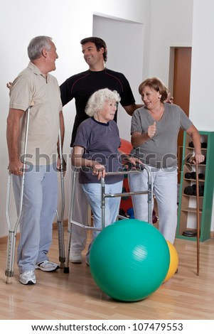 Happy Male Physical therapist with patient . - stock photo