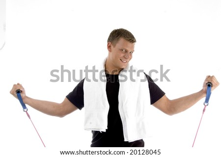 happy male with exercising rope on an isolated background - stock photo