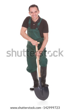 Happy Male Worker Holding A Shovel Over White Background - stock photo