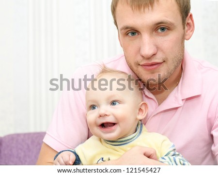 Happy man and baby boy   at home - stock photo