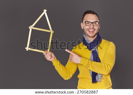 Happy man architect designer showing house home concept  - stock photo