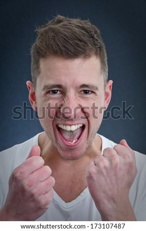happy man celebrating and screaming - stock photo
