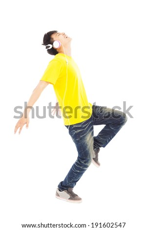 happy man dancing while listening music  - stock photo