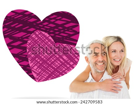 Happy man giving his partner a piggy back against hearts - stock photo