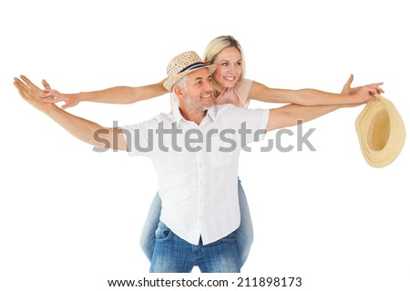 Happy man giving his partner a piggy back on white background - stock photo