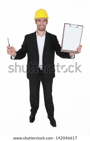 Happy man holding clip-board and pen - stock photo
