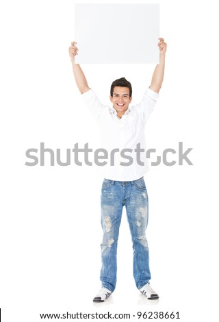 Happy man holding up a banner ad - isolated over a white background - stock photo