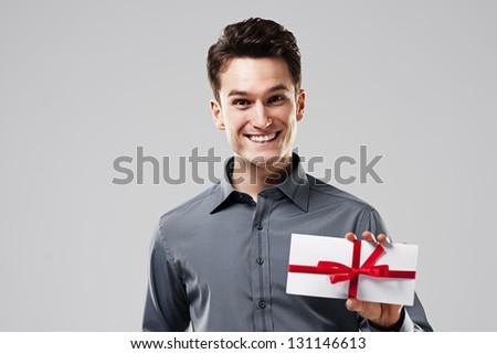 Happy man holding white card - stock photo