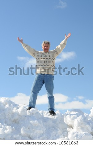 Happy man in a sweater - stock photo