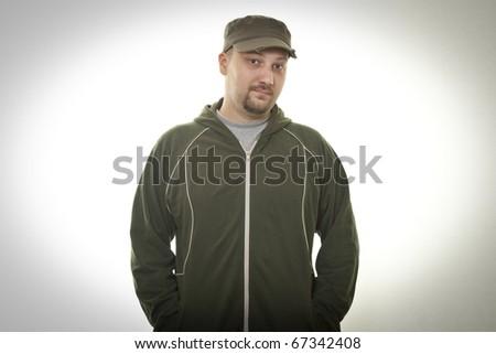 happy man in jacket and cap posing - stock photo