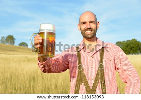 happy man in traditional bavarian garb - stock photo