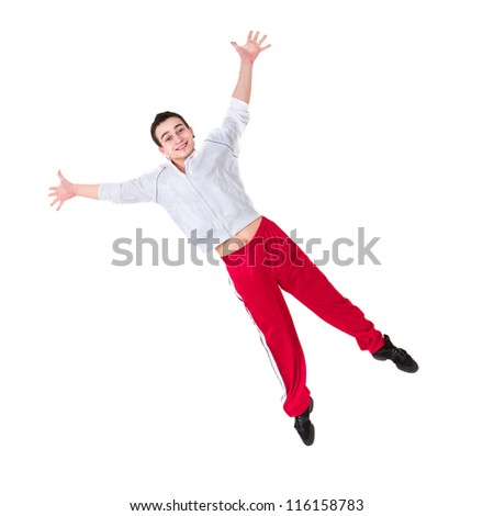 Happy man jumping against isolated white background - stock photo