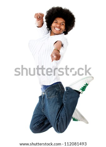 Happy man jumping and pointing at the camera - isolated over white - stock photo