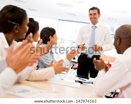 Happy man making a successful business presentation - stock photo