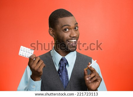 Happy man offering nicotine chewing gum help with cigarette addiction isolated red background. Positive face expression. Health care, bad human habits, prevention concept. Smoke cessation program - stock photo