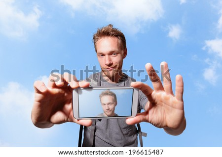 happy man selfie by smart phone with sky background, caucasian - stock photo