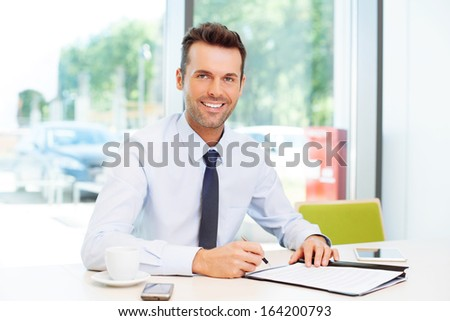 Happy man signing contract. Business concept - stock photo