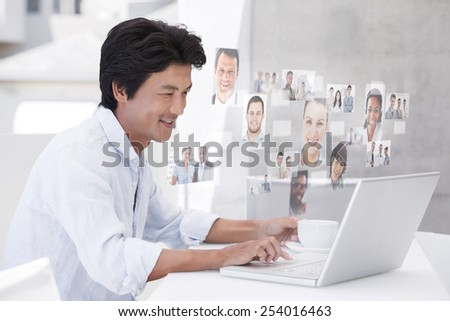 Happy man using laptop while having a coffee against business people - stock photo