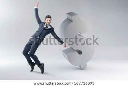 Happy man with dollar mark - stock photo