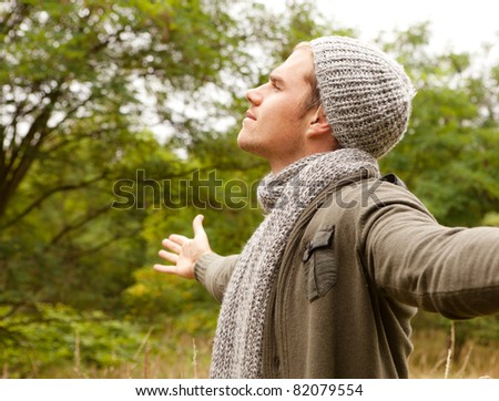 happy man with green outfit - stock photo