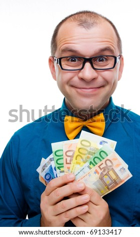 Happy man  with handful of money isolated on white background - stock photo