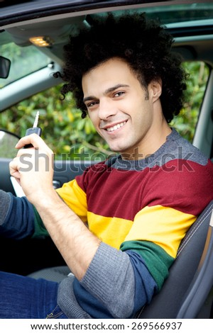 Happy man with new car smiling - stock photo