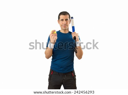 Happy man with paddle racket looking at camera - stock photo