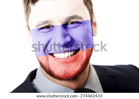 Happy man with Russia flag painted on face. - stock photo