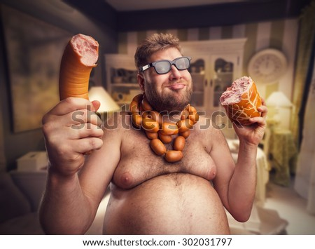 Happy man with sausages - stock photo