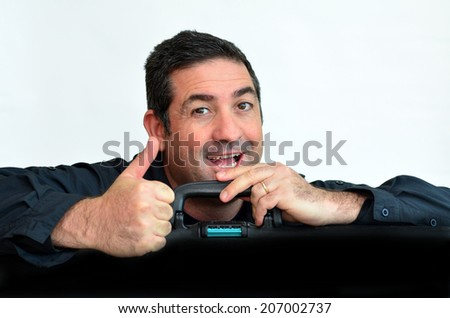 Happy man with suitcase go to travel against white background with copy space. Concept photo of travel, vacation, holiday, destination, tourism, traveler, tourist. - stock photo