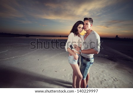 Happy married couple at the beach .Fashion photo - stock photo