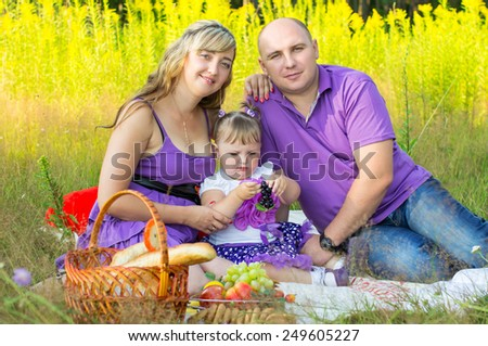 Happy married couple on nature, picnic - stock photo