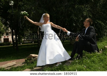 Happy married. Newlywedses on walk in park. This photo is not correction. - stock photo
