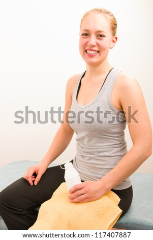 Happy masseur after the massage, white wall on background - stock photo