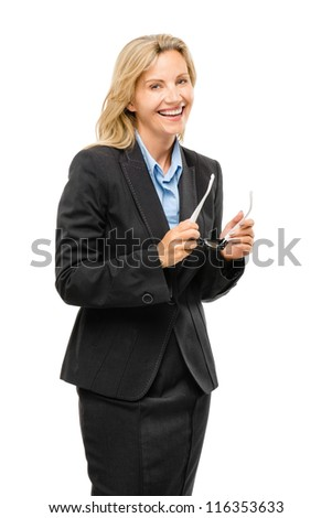 Happy mature business woman holding glasses isolated on white background - stock photo