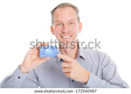 Happy Mature Businessman Holding Credit Card Over White Background - stock photo