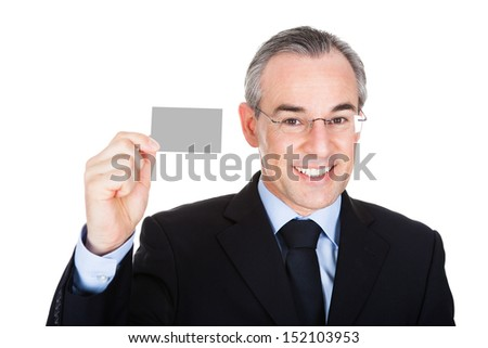 Happy Mature Businessman Showing Blank Visiting Card Over White Background - stock photo
